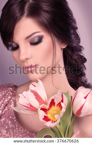 Beauty Girl with flovers. Beautiful Young Woman with Fresh Clean Skin, Beautiful Face. Pure Natural Beauty. Perfect Skin. Isolated on a Grey Background. Portrait of Beauty Girl. - stock photo