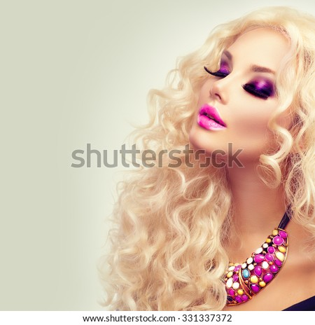 Beauty Girl With Healthy Long Curly Hair. Blonde Woman Portrait. Blond Wavy Hair and bright makeup, vivid make-up, purple lips, smoky eyes and false eyelashes. Holiday make up. Perfect skin - stock photo