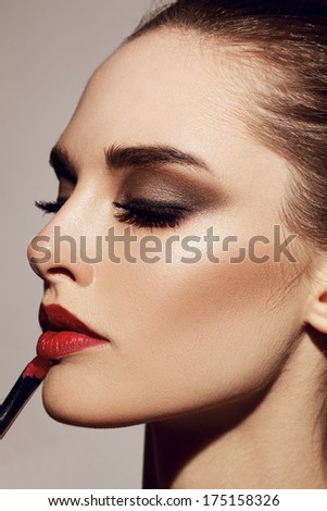 Beauty Girl with Makeup Brushes - stock photo