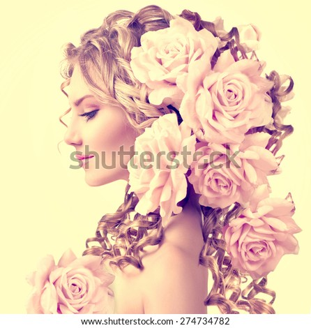 Beauty girl with rose flowers hairstyle isolated on white background. Fashion model  woman portrait with pink flowers. Summer fairy portrait. Long permed curly hair. Perfect make up - stock photo