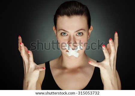 beauty girl with tape on lips - stock photo