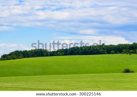 beauty green summer rural landscape view on blue sky backgrounds - stock photo