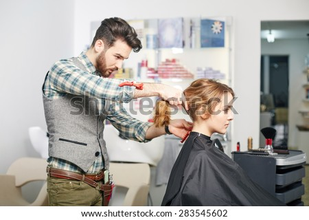 beauty, hairstyle and people concept. Happy young woman and hairdresser - stock photo