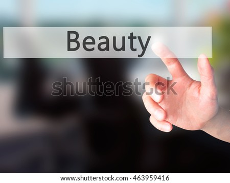Beauty - Hand pressing a button on blurred background concept . Business, technology, internet concept. Stock Photo