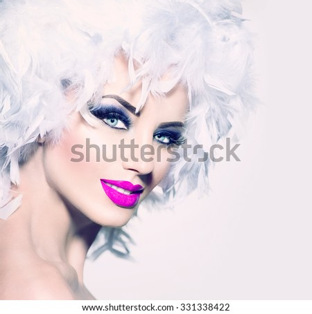 Beauty Holiday makeup. Fashion Model Girl with White Feathers Hair style and bright make up. Beautiful woman with feathers on her head. Hairstyle. Holiday Creative Makeup - stock photo