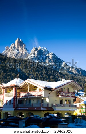 Beauty Hotel In Alps. Winter Travel Series. - stock photo