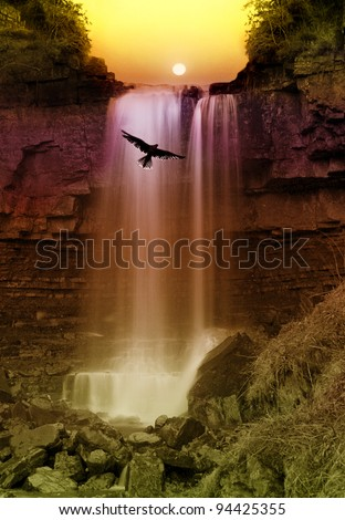 Beauty in Nature, with a long exposure capture with Bird of Prays wingspan back light by sunset and spray off Waterfall - stock photo