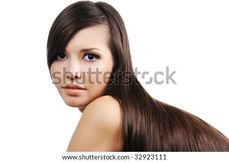beauty in portrait of pretty attractive young girl with long brown hairs - stock photo