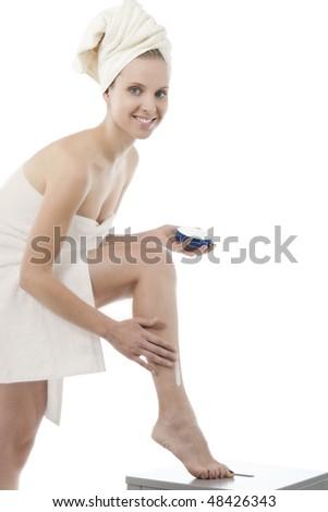 Beauty in towel applying moisturizer - stock photo