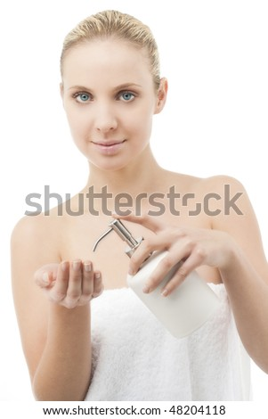 Beauty in towel with liquid soap dispenser - stock photo