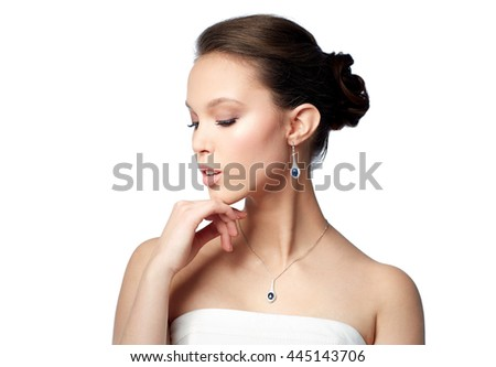 beauty, jewelry, wedding accessories, people and luxury concept - beautiful asian woman or bride with earring and pendant - stock photo
