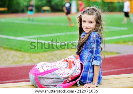 Beauty kid girl supporting school soccer team at the stadium - stock photo