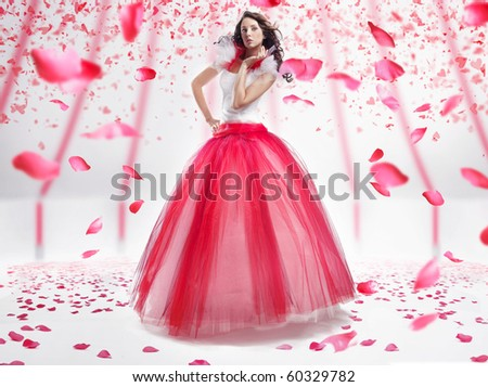 Beauty lady with roses flakes - stock photo