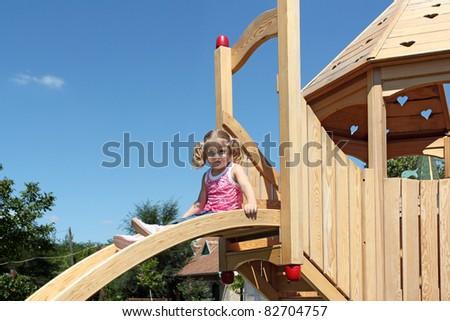 beauty little girl on playground - stock photo