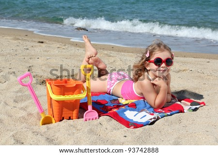 beauty little girl on the beach - stock photo
