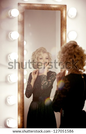 Beauty luxury woman with  and mirror - stock photo