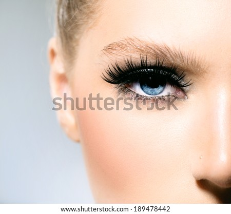 Beauty makeup for blue eyes. Part of beautiful face closeup. Perfect skin, long eyelashes. Make up concept.  - stock photo