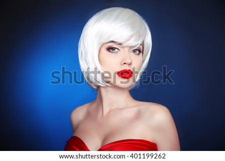 Beauty Makeup. Short hairstyle. White bob hair style. Blonde young sensual woman with red lips isolated on dark blue background. - stock photo
