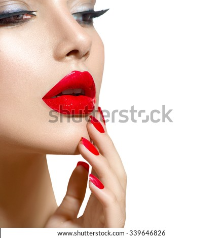 Beauty model Girl with Red Sexy Lips and Nails closeup. Manicure and Makeup. Make up concept. Beautiful woman face closeup over white. Filler injections. Lip augmentation, Beautiful Perfect Lips. - stock photo