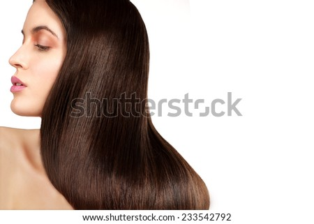 Beauty model showing perfect skin and long healthy brown hair on white - stock photo