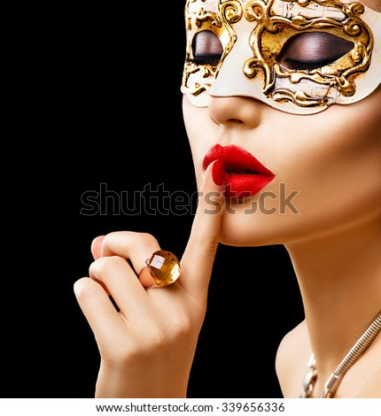 Beauty model woman wearing venetian masquerade carnival mask at party isolated on black background  Christmas and New Year celebration. Glamour lady with perfect make up and accessories - stock photo