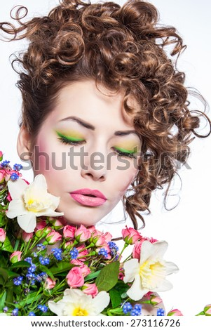 Beauty model Woman with Spring flowers over white background