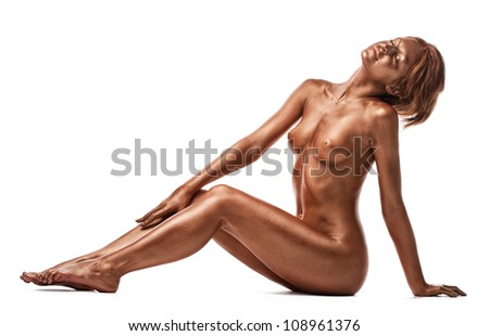 Beauty naked woman with metal skin - stock photo