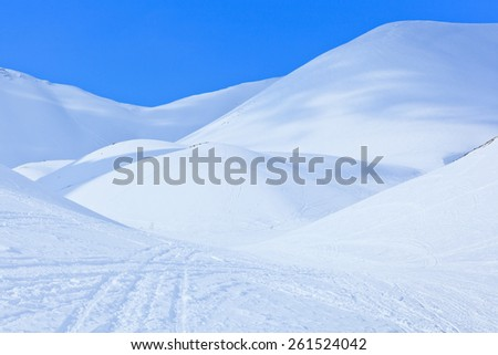 Beauty of nature. Winter landscape with snowy hills like dunes under a blue sky above the Arctic Circle, Russia, Hibiny, Murmansk region - stock photo