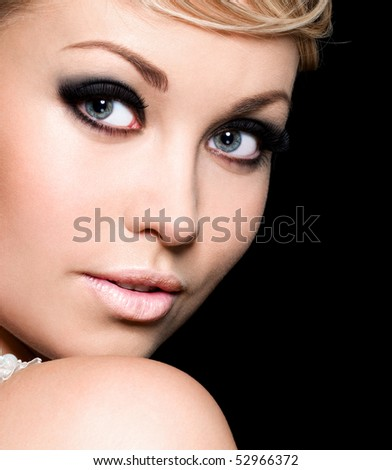 Beauty of the young pretty woman's face with fashion make-up - stock photo