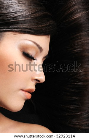 beauty of young beautiful sleeping girl at background of her hair - stock photo