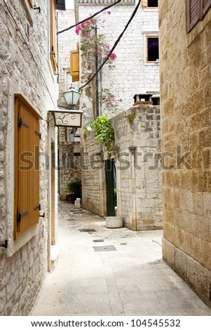 Beauty old narrow alley in UNESCO town, Trogir - Croatia. - stock photo