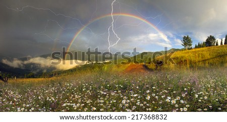 Beauty panorama of mountain meadows in Transcarpathia - is the abundance of vegetation on the background of beautiful tops and interesting weather conditions. Thunder  of lightning danger to tourists - stock photo