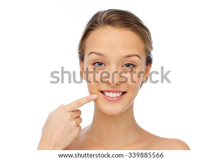 beauty, people and health concept - smiling young woman face and shoulders - stock photo