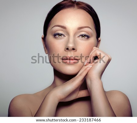 Beauty Portrait. Beautiful MulattoWoman Touching her Face. Perfect Fresh Skin. Pure Beauty Model Girl. Youth and Skin Care Concept  - stock photo
