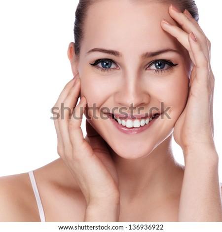 Beauty Portrait. Beautiful Spa Woman Touching her Face - stock photo