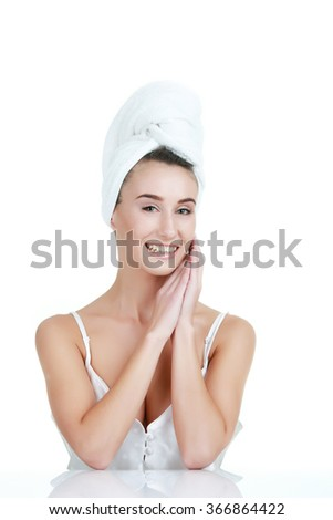 Beauty Portrait. Beautiful Spa Woman Touching her Face. Perfect  - stock photo
