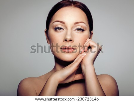 Beauty Portrait. Beautiful Spa Woman Touching her Face. Perfect Fresh Skin. Pure Beauty Model Girl. Youth and Skin Care Concept  - stock photo