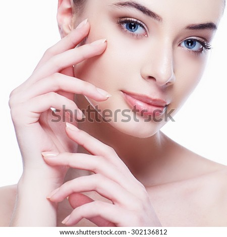 Beauty Portrait. Beautiful Spa Woman Touching her Face. Perfect Fresh Skin. Pure Beauty Model Girl. - stock photo