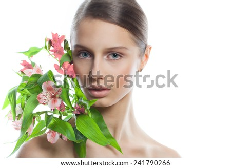 Beauty Portrait. Beautiful Spa Woman with flowers in shoulders. Perfect Fresh Skin. Pure Beauty Model Girl. Youth and Skin Care Concept - stock photo