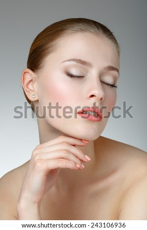 Beauty Portrait. Beautiful Woman Touching her Face. Perfect Fresh Skin. Pure Beauty Model. Youth and Skin Care Concept.  - stock photo