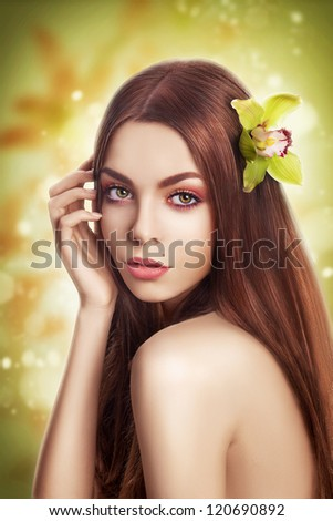 Beauty Portrait Brunette Model with Healthy Straight Hair with Flower - stock photo