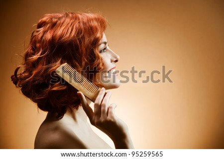 Beauty Portrait. Curly Hair and Comb - stock photo