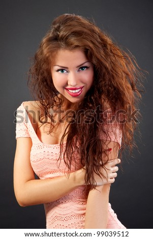 Beauty Portrait. Curly Hair. Beautiful woman. Shot in a studio on a black background