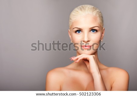 Beauty portrait face of happy smiling beautiful blond woman with blue eyes and smooth skin, aesthetics cosmetics skincare concept.