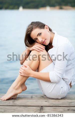 beauty portrait from an attractive young woman - stock photo