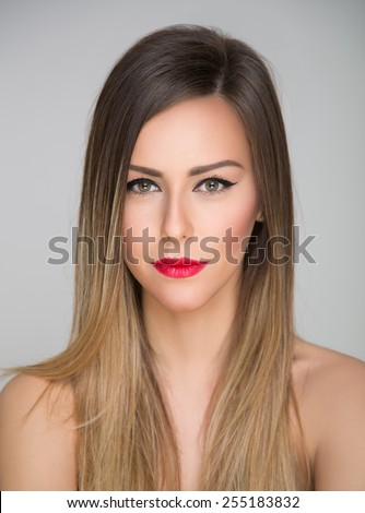 Beauty portrait of a girl with mysterious smile - stock photo