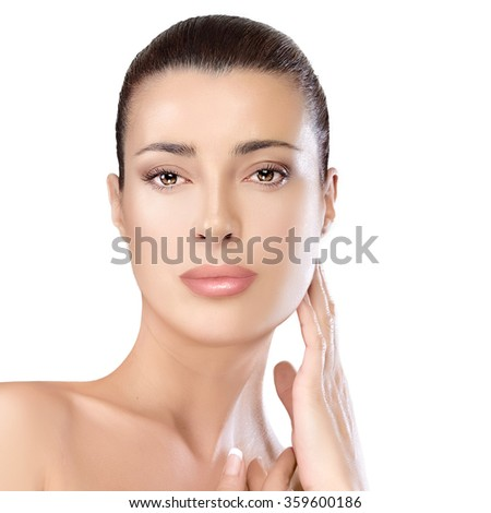 Beauty portrait of a gorgeous natural young woman with bare shoulders looking at the camera with a serene expression suitable for skincare and spa concepts, isolated on white - stock photo