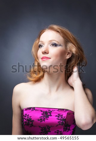 Beauty portrait of a sensitive red-haired woman with music makeup