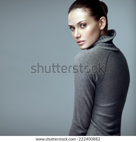 Beauty portrait of a sensual brunette model with brown hair. - stock photo