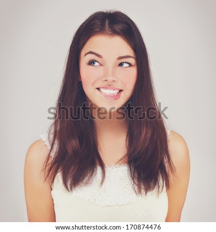 Beauty portrait of a young brunette woman with beautiful smile - stock photo